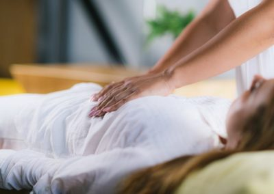 reiki-healing-treatment-with-woman-1024x554